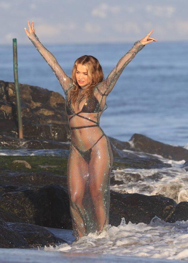 Rita Ora - recording her new music video on the beach In Malibu
