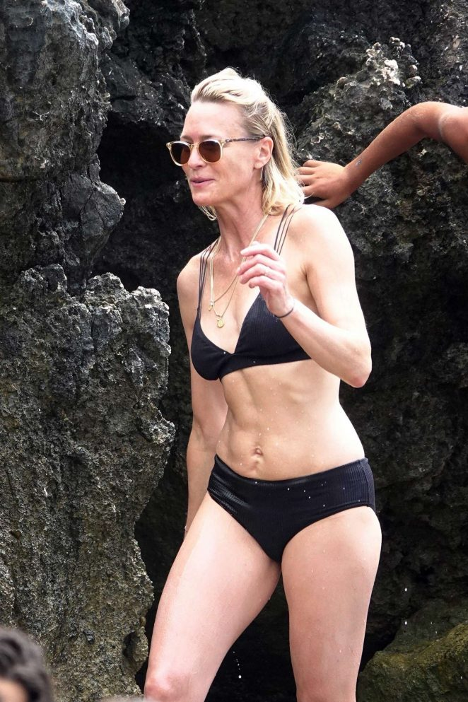Robin Wright in Black Bikini with Clement Giraudet in Capri