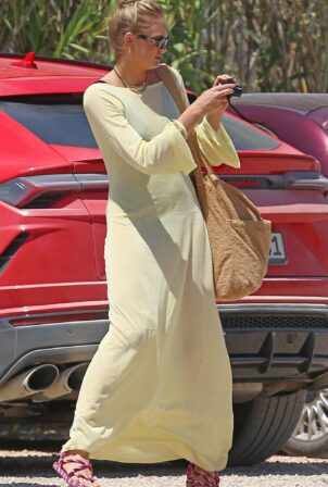Romee Strijd - In a maxi yellow dress out for lunch at Casa Jondal in Ibiza