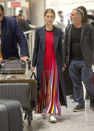 Rosamund Pike - Arrives at Heathrow Airport in London