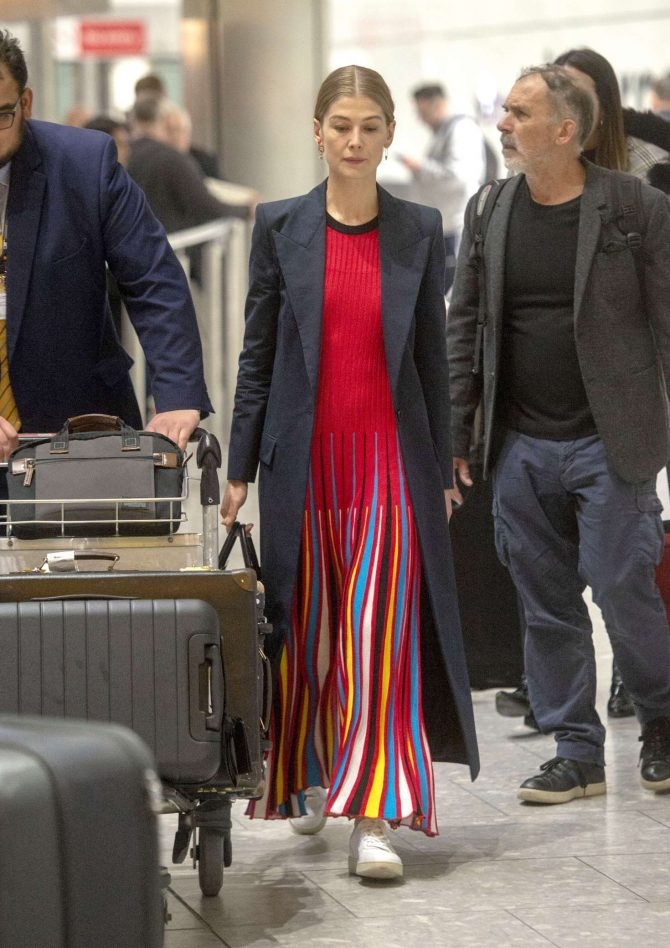 Rosamund Pike – Arrives at Heathrow Airport in London