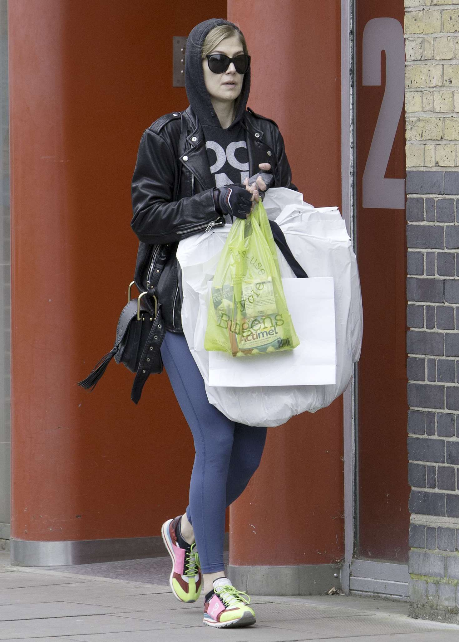 Rosamund pike picking up her dry cleaning in london new images