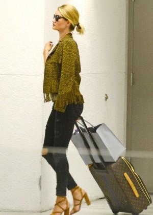 Rosie Huntington Whiteley at Airport in Miami