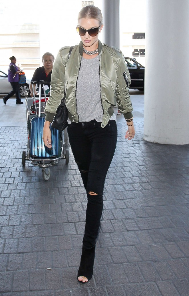Rosie Huntington Whiteley in Ripped Jeans at LAX in LA