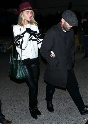 Rosie Huntington-Whiteley & Jason Statham at LAX airport in LA