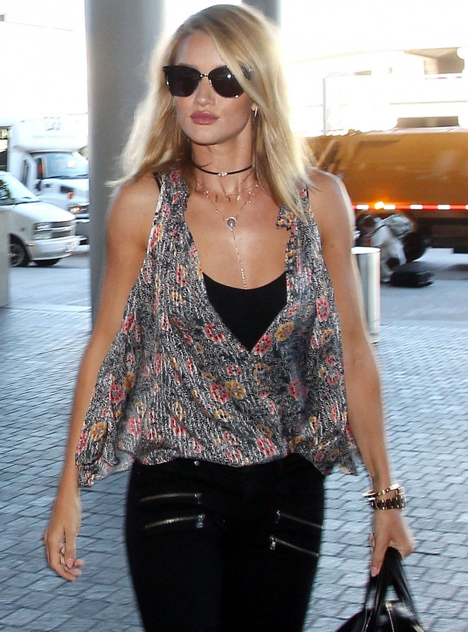 Rosie Huntington Whiteley in Tight Jeans at LAX Airport in LA