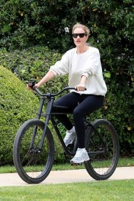 Rosie Huntington Whiteley on her Bike in California