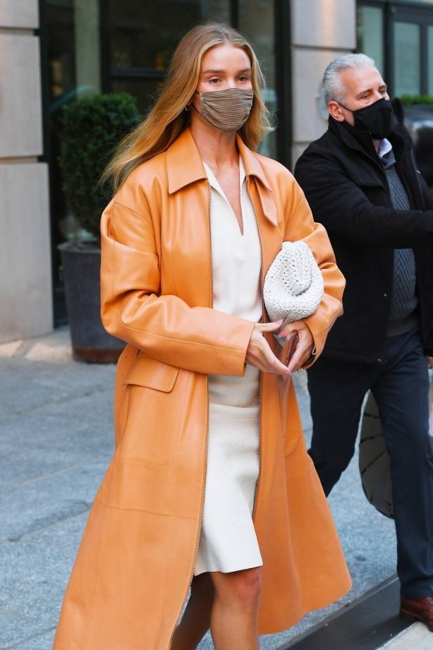 Rosie Huntington-Whiteley - With a coral-hued trench coat in New York
