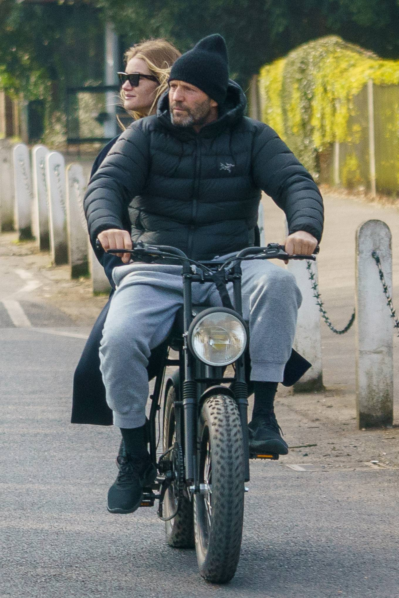 Rosie Huntington-Whiteley 2021 : Rosie Huntington-Whiteley – With Jason Statham ride electric bike in London-01