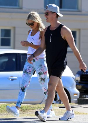 Roxy Jacenko with her husband Oliver Curtis at Bondi Beach