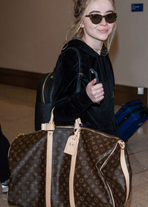 Sabrina Carpenter - Arrives at LAX Airport in Los Angeles