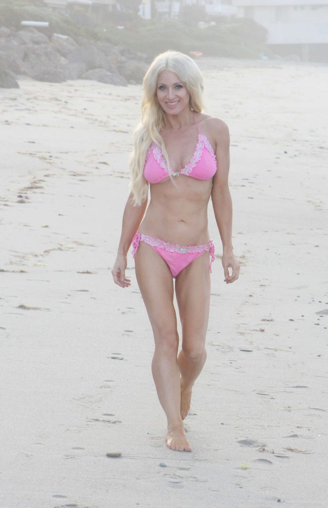 Sara Barrett in Pink Bikini on the beach in Malibu
