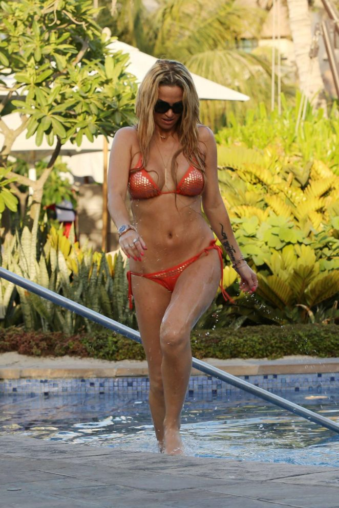 Sarah Harding in Bikini at a pool in Dubai
