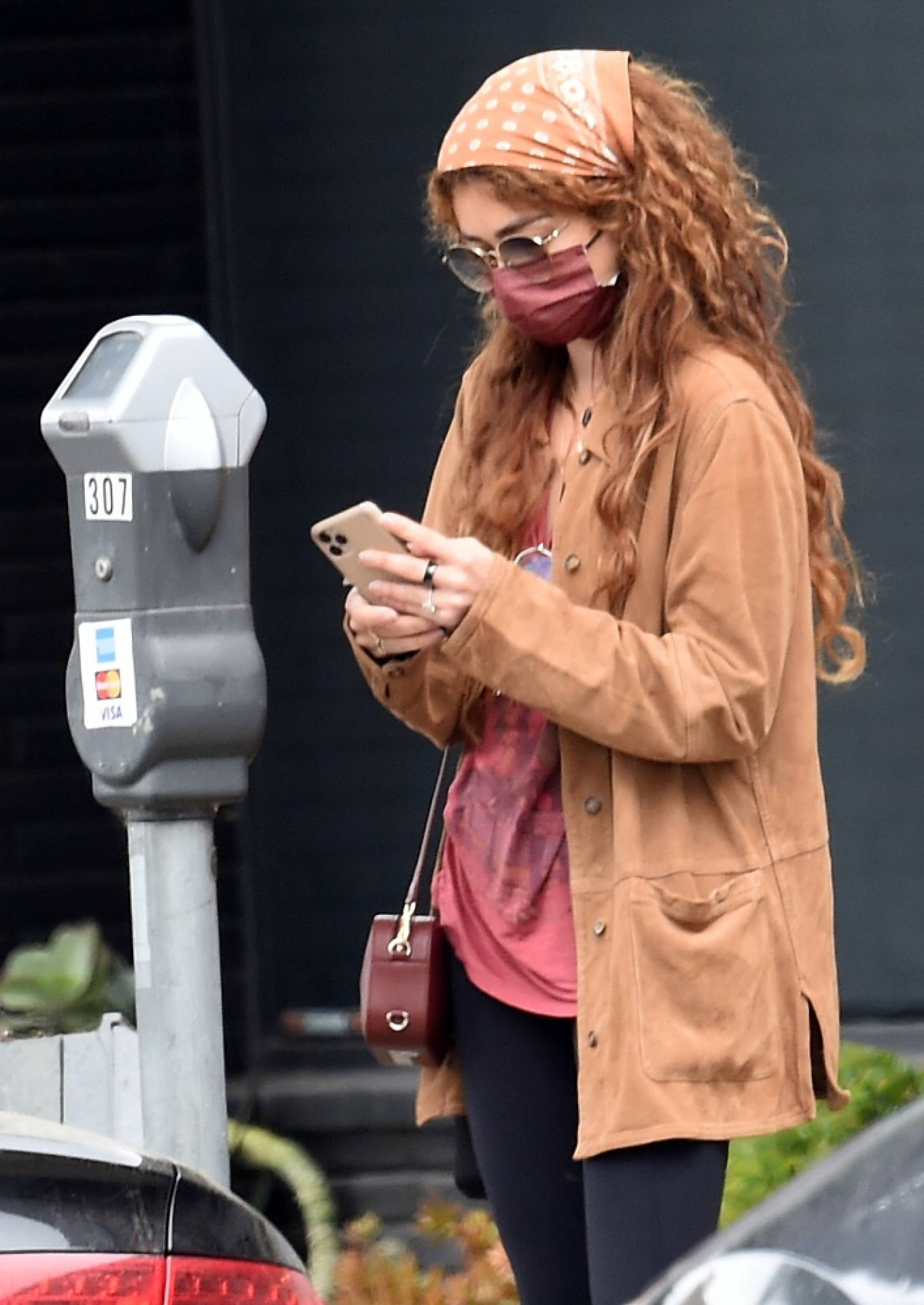 Sarah Hyland - feeds the parking meter in West Hollywood