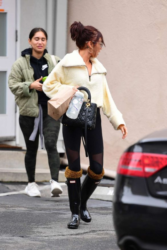 Sarah Hyland in Black Tights and Hunter Wellies Boots - Out and about in Los Angeles