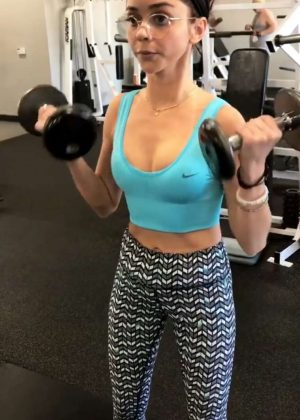 Sarah Hyland in Leggings and Crop Top Workout