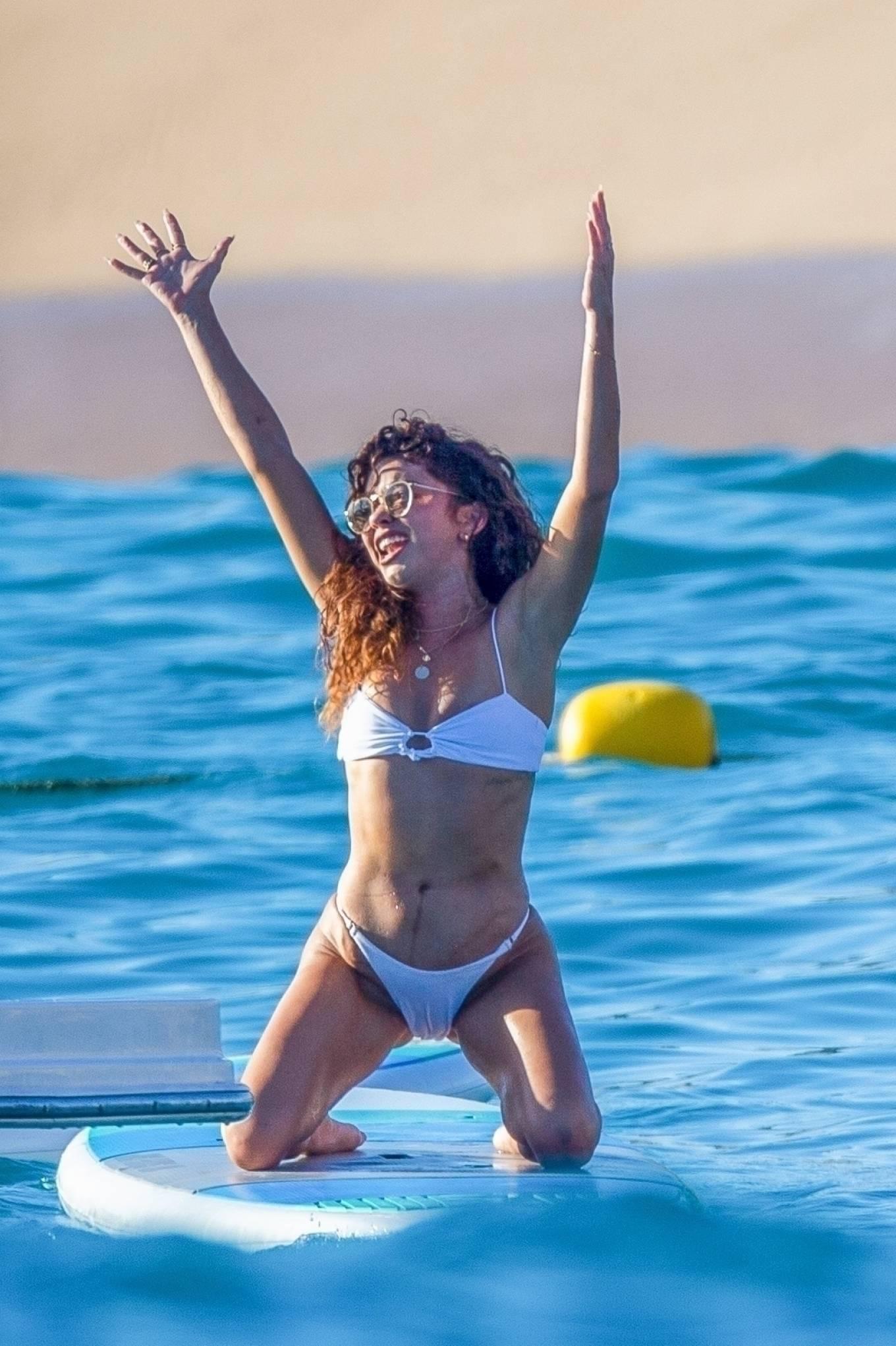 Sarah Hyland - In sizzling high-rise bikini on a boat in Cabo San Lucas