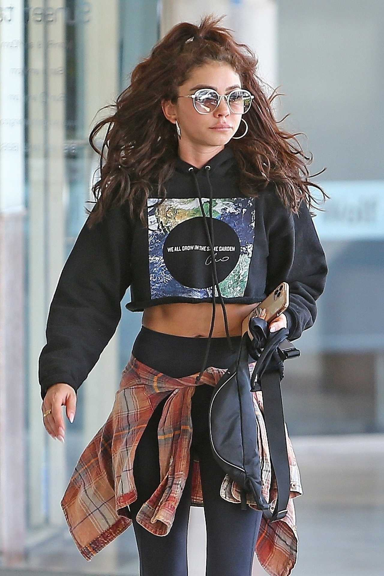 Sarah Hyland - Shows her tanned abs in Los Angeles