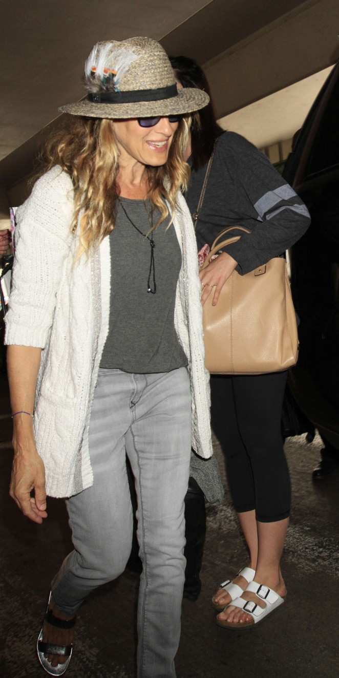 Sarah Jessica Parker in grey jeans at LAX in Los Angeles