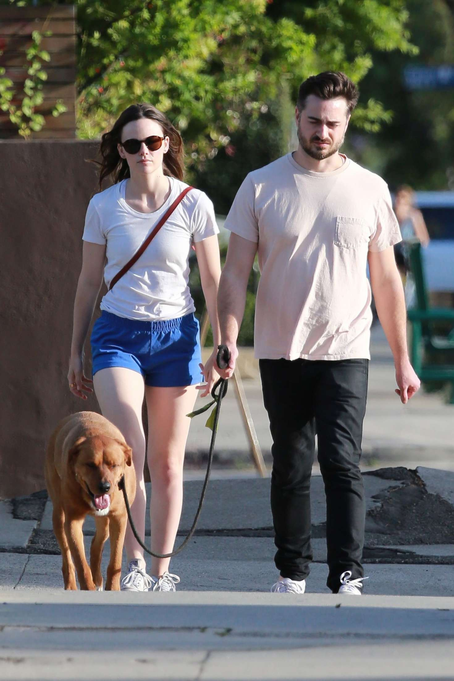 Sarah Ramos with director boyfriend Matt Spicer walking their dog