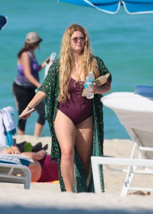 Sasha Pieterse in Purple Swimsuit at the beach in Miami