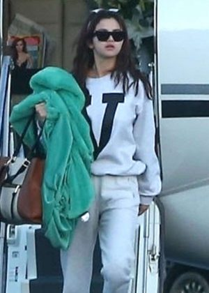 Selena Gomez - Arriving with friends to a private jet in Los Angeles