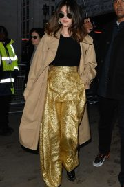 Selena Gomez in Gold Pants and Beige Coat - Out and about in London