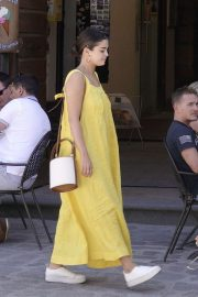 Selena Gomez in Long Yellow Dress - Arrives on a helicopter in Civita di Bagnoregio