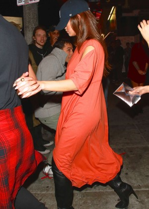Selena Gomez in Orange Dress at Roxy Theatre in West Hollywood