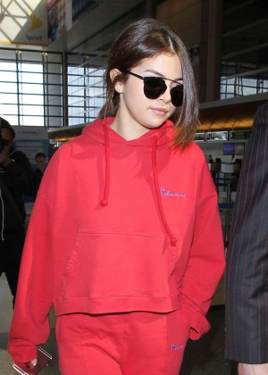 Selena Gomez in Red at LAX airport in Los Angeles