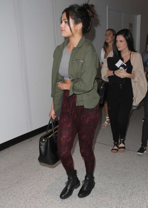 Selena Gomez in Red Tights at LAX Airport in LA