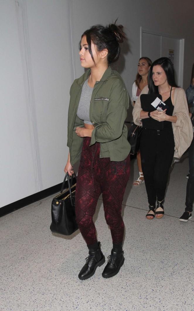 Selena Gomez in Red Tights at LAX Airport in LA