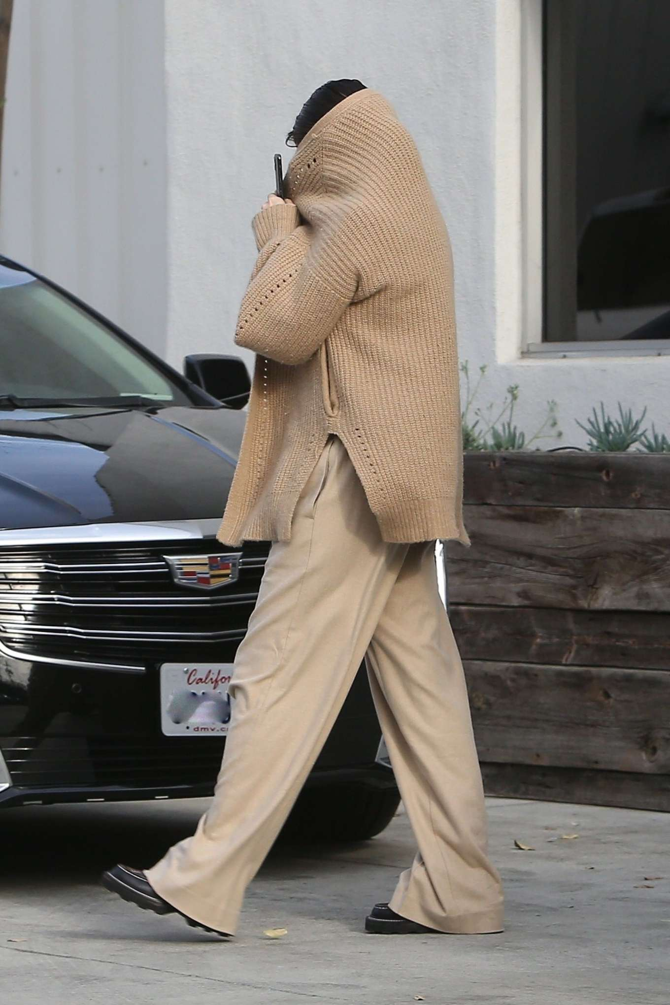 Selena Gomez - Seen while covers her face leaving the dance studio in Burbank