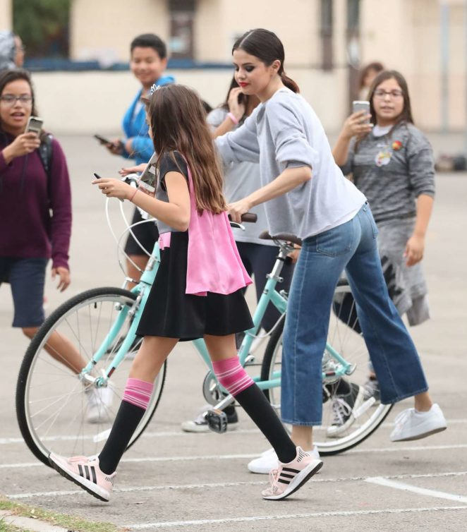 Selena Gomez – Shoots hoops with students in LA