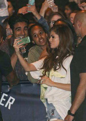 Selena Gomez in Jeans Shorts with her fans -13