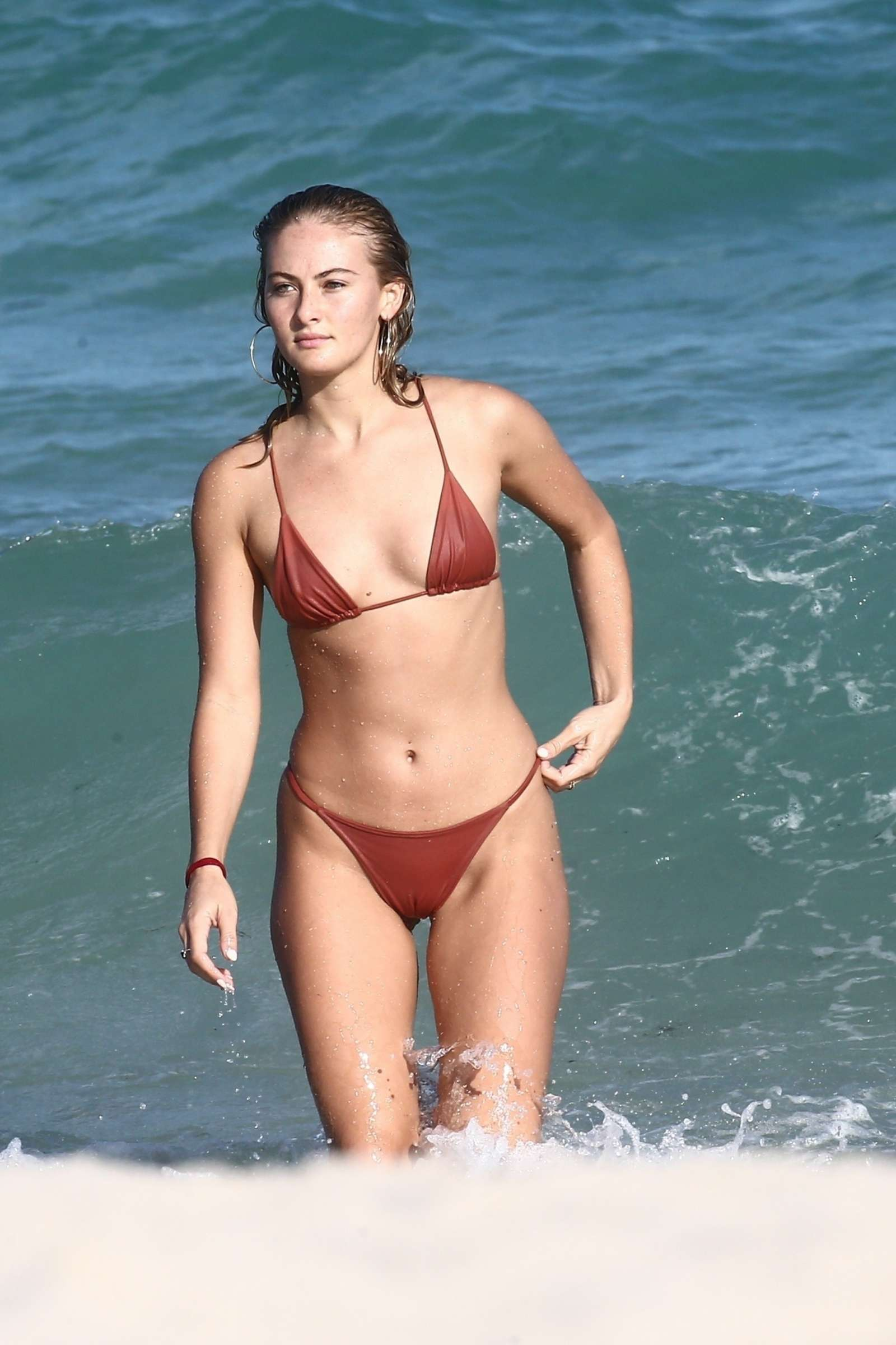 Selena Weber in Red Bikini at a beach in Miami