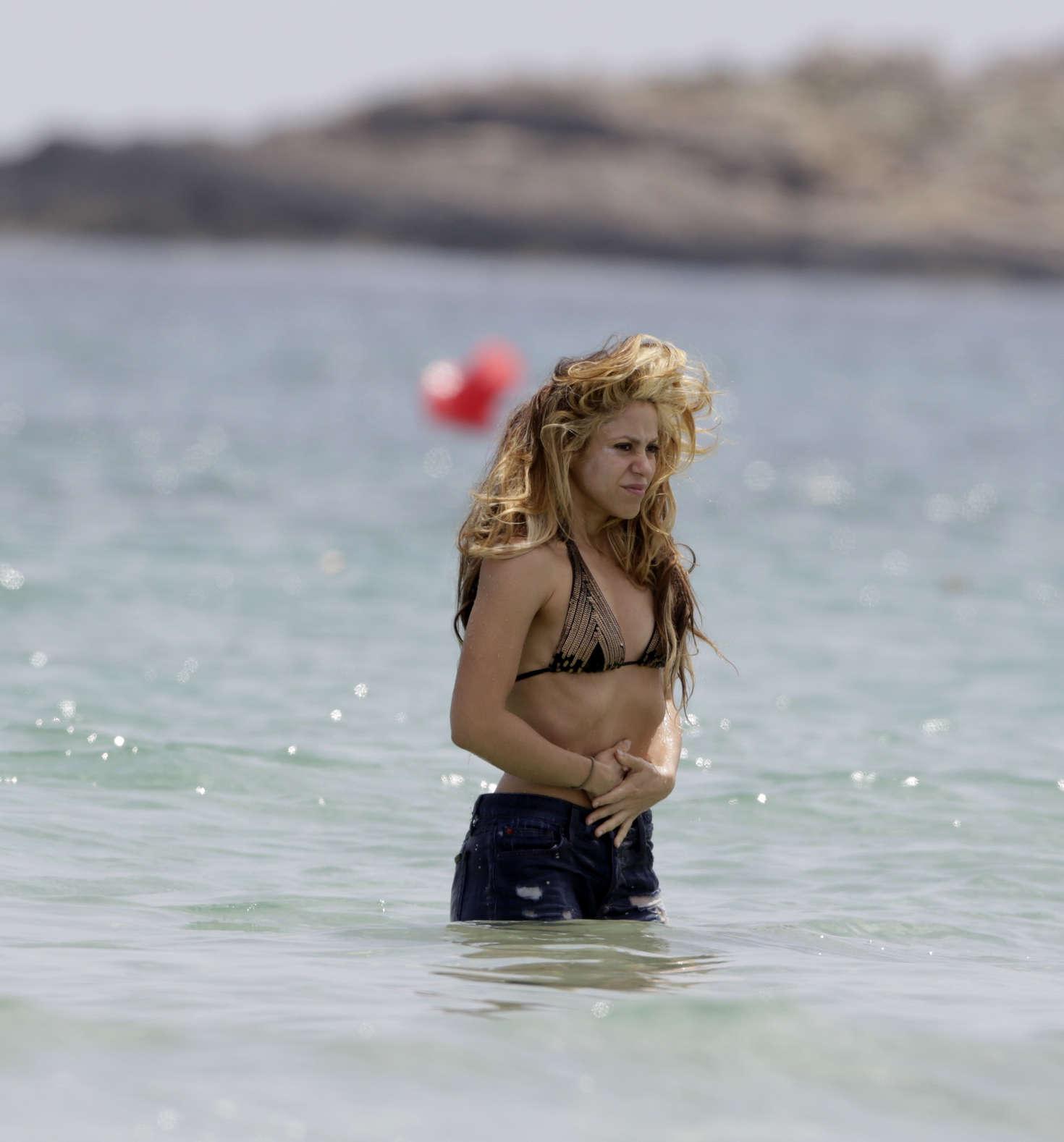 Shakira Poses In Purple Bikini She Designed Herself