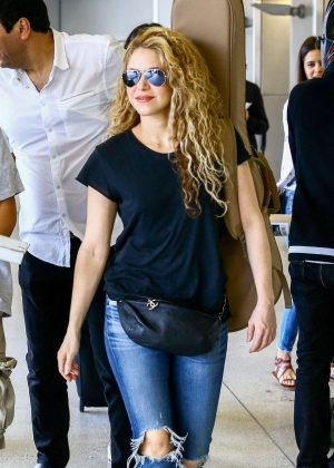 Shakira in Ripped Jeans at Airport in Miami