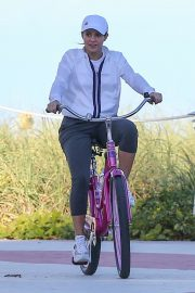 Shakira - Riding a bike at the beach in Miami