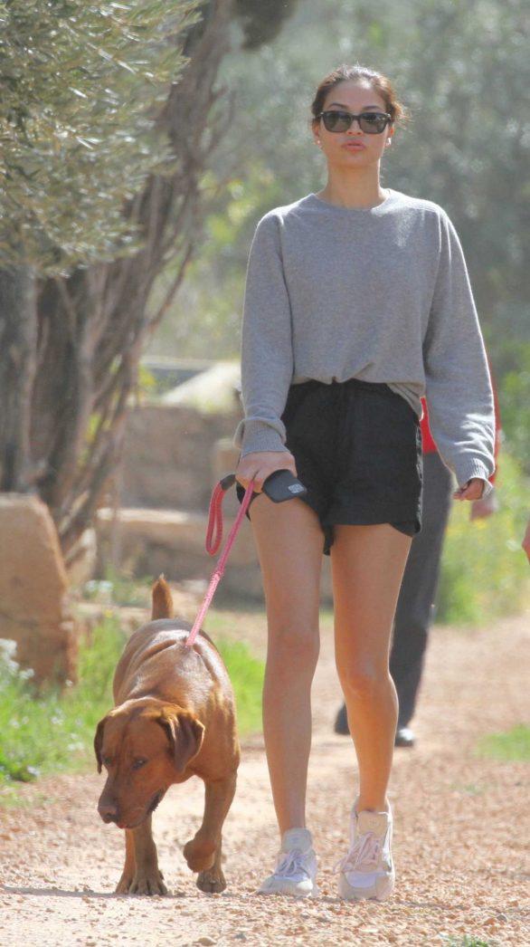 Shanina Shaik in Shorts - Walking her dog on holiday in Ibiza