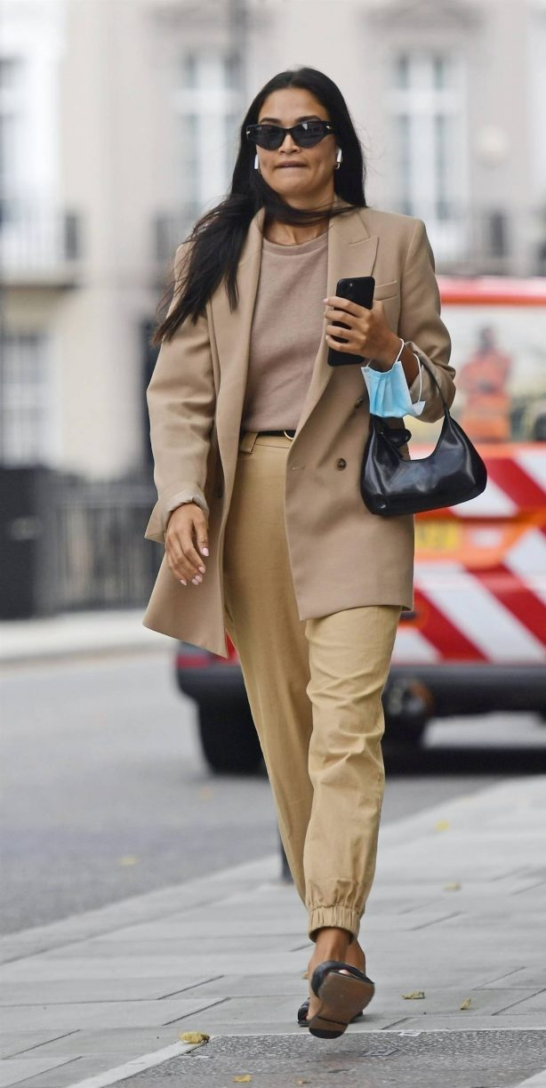 Shanina Shaik - Stylish in her beige trousers and jacket while out in London