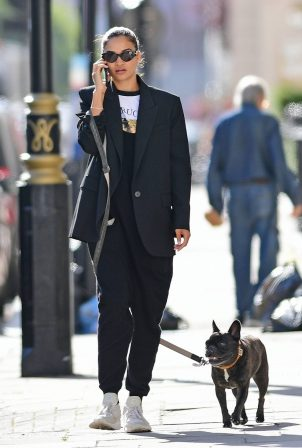 Shanina Shaik - With her french bulldog in London