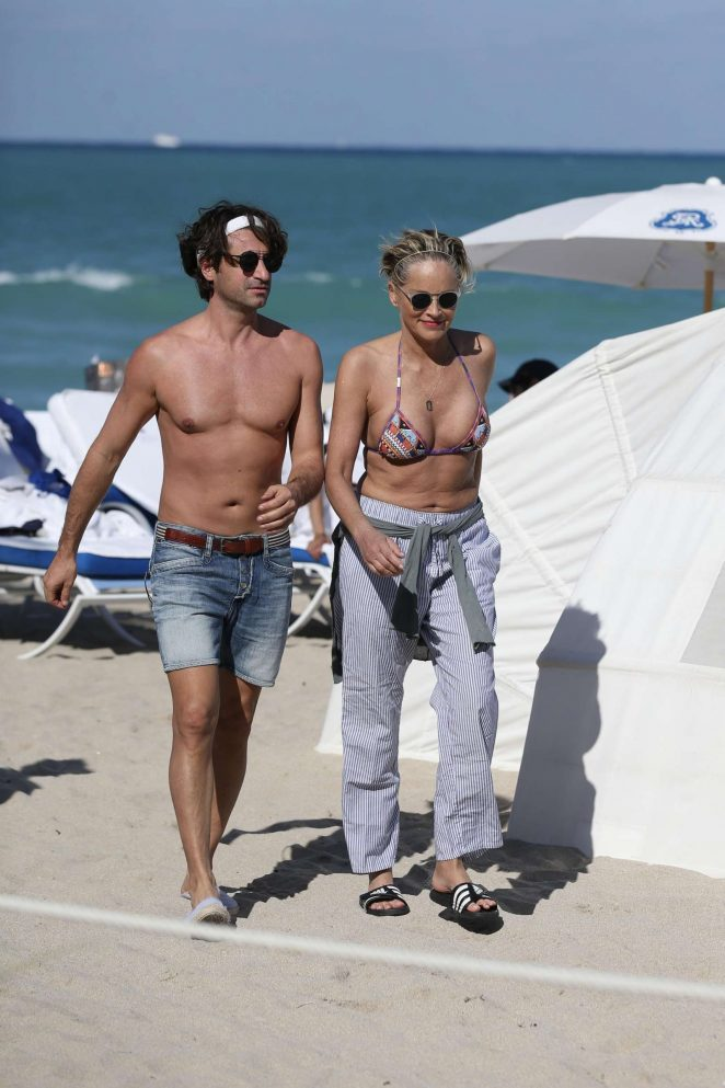Sharon Stone in Bikini Top with her boyfriend at the beach in Miami