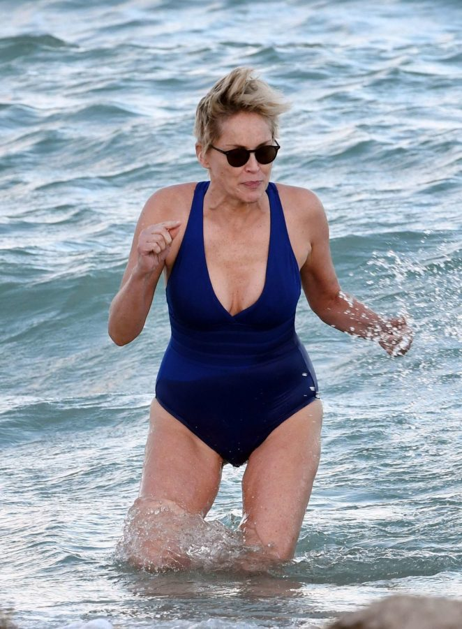 Sharon Stone in Blue Swimsuit on the beach in Miami