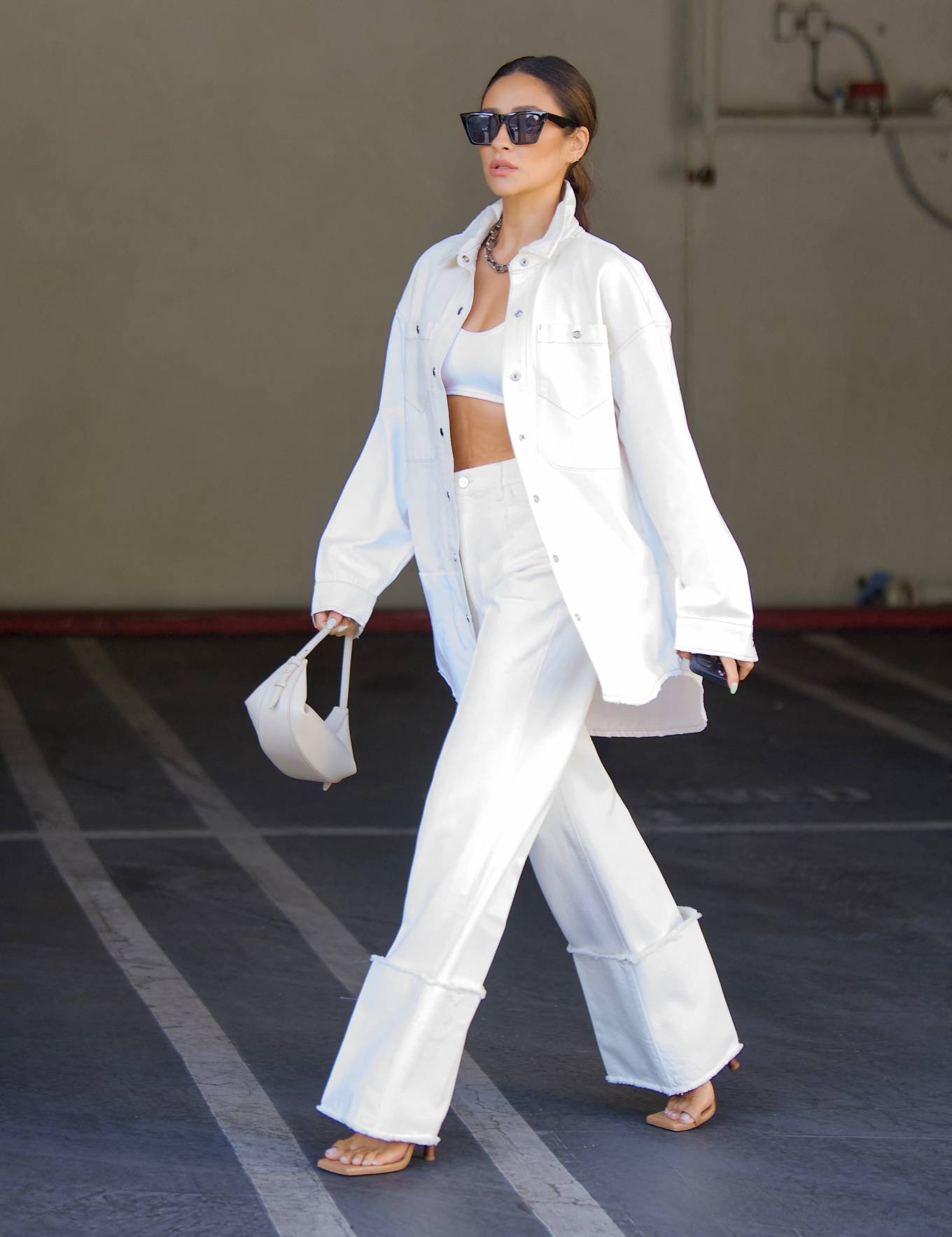 Shay Mitchell - in crop top and white denim out in Los Angeles