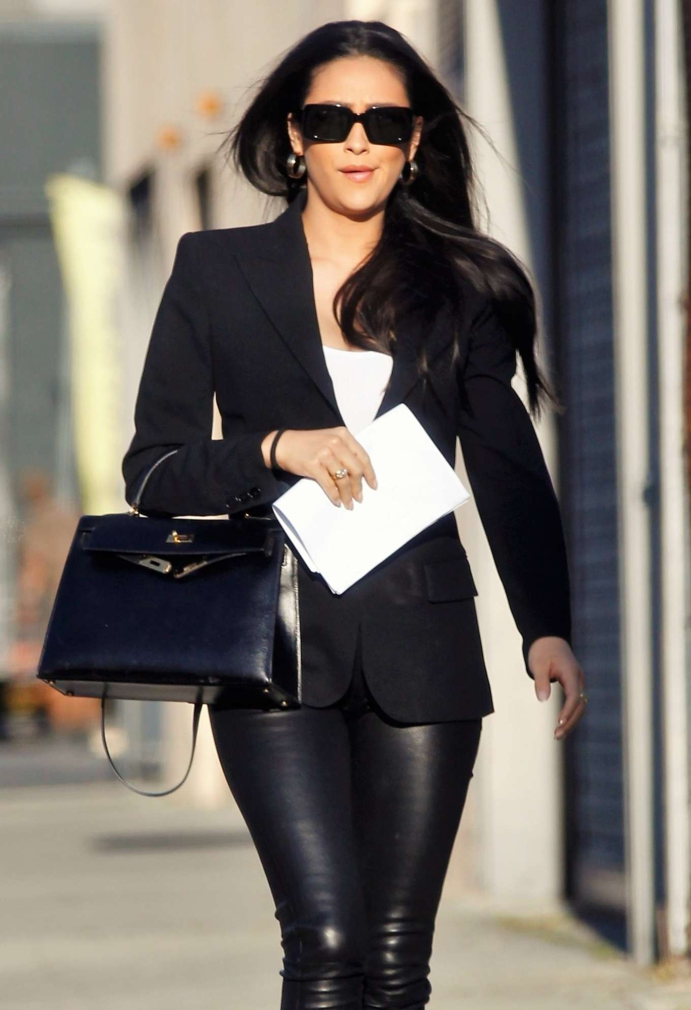 Shay Mitchell - In leather pants is back to work in Culver City
