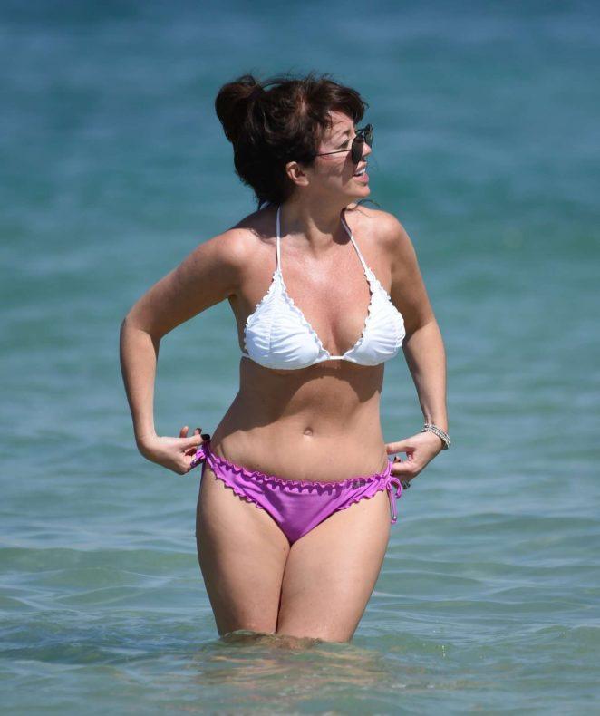 Sheree Murphy in White and Purple Bikin on the Beach in Dubai