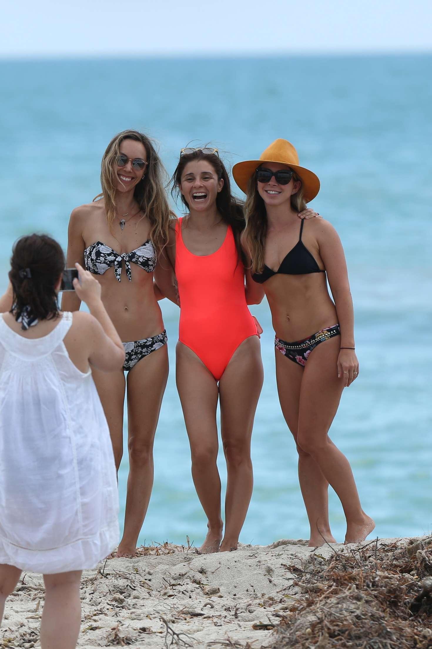 Shiri Appleby Wears A Orange One Piece Swimsuit To The