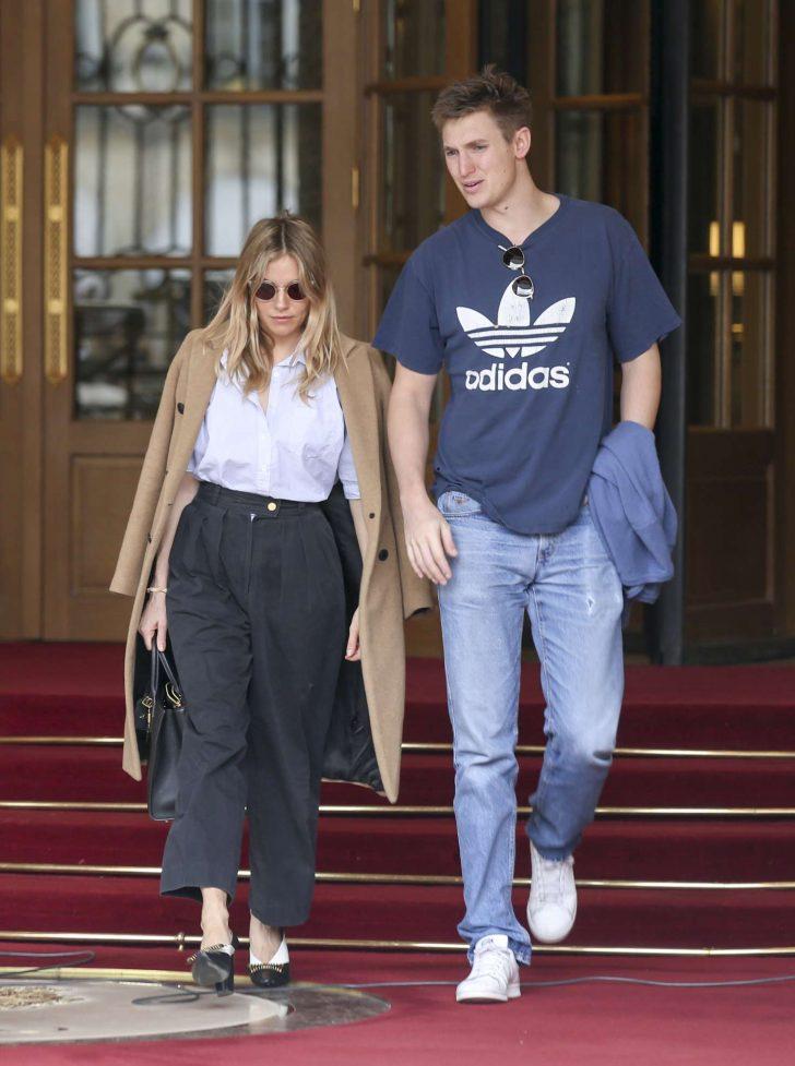 Sienna Miller and boyfriend Lucas Zwirner - Leave their hotel in Paris