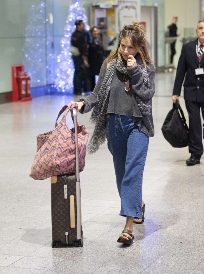 Sienna Miller – Arrives at Heathrow Airport in London
